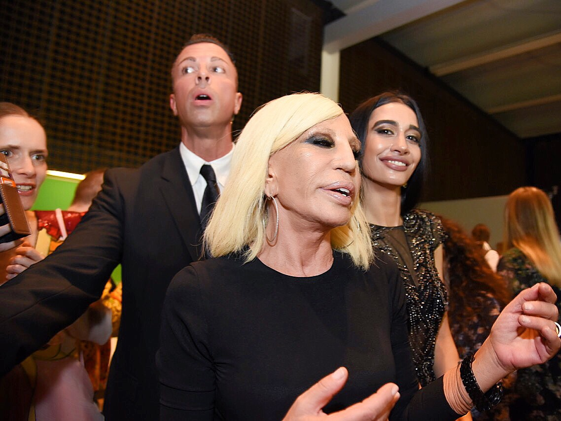 THAT AMAZING MOMENT when you are getting mobbed by fans again on the Versace S/S 2017 runway and DONATELLA VERSACE HERSELF has to whisk you away backstage with her personal bodyguard! 🙀🙀🙀 GRAZIE MILLE MAMMA DONATELLA, many don't know what a shy and sweet, gentle soul you are. You care for all of your Versace Dolls, and it truly shows. THANK YOU CARA MIA, FOR ALL YOU DO & FOR THE INCREDIBLE OPPORTUNITY TO BE A PART OF LA FAMIGLIA VERSACE AT MILAN FASHION WEEK!!! (Photo credit: Gabriela Di Muro) 👸🏼
