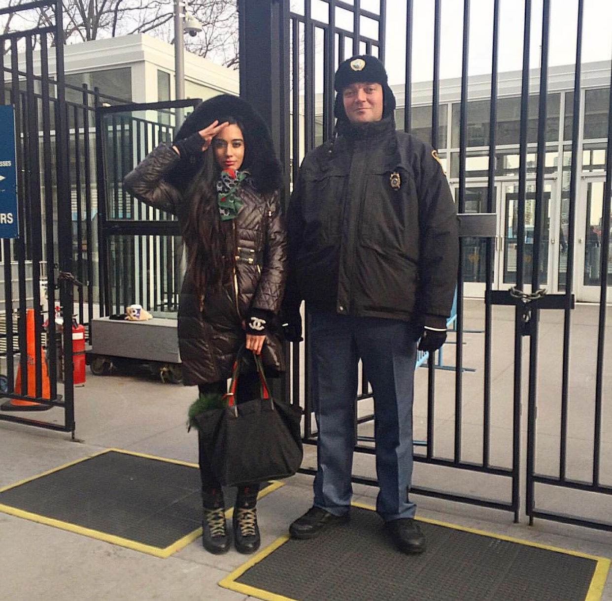 SALUTE! Outside the United Nations entrance gates with one of my favorite security guards!